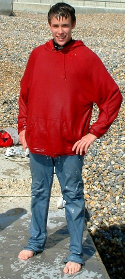 Protect your wetsuit in rough waters with jeans and hoodie.